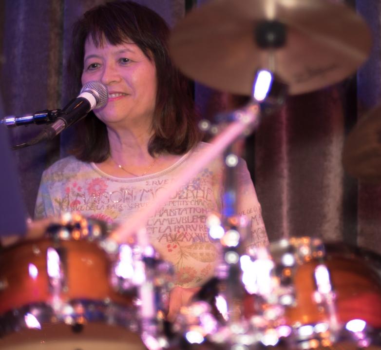 Collette d'Almeida (drums, vocals - Angelicas 7-14 show)